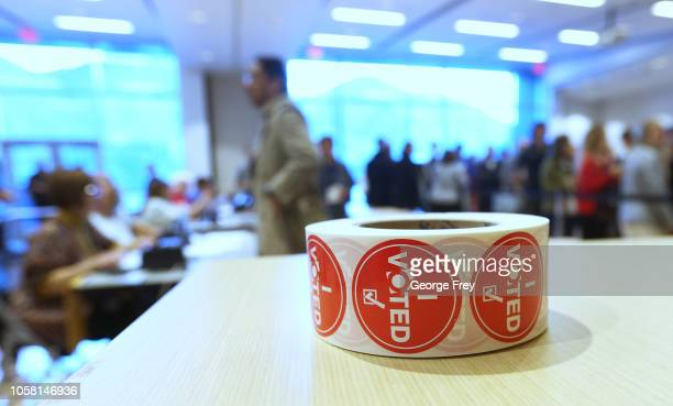 'I Voted' stickers sit on a table at a polling center as people line up to vote in the midterm elections on November 6 2018 in Provo Utah Utah early...