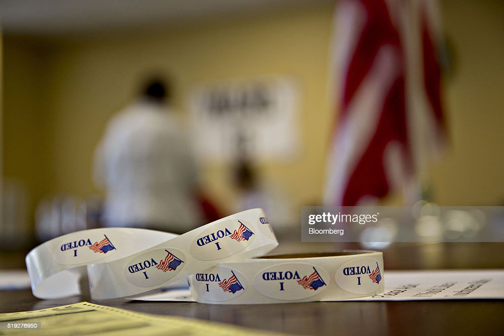 'I Voted' stickers sit on a table at a polling location during the presidential primary vote in Waukesha, Wisconsin, U.S., on Tuesday, April 5, 2016. Wisconsin voters went to the polls Tuesday to decide whether Donald Trump's latest self-inflicted wounds are deep enough to deny him a win in the state's Republican primary, and, in turn, to diminish his hopes of winning the presidential nomination. Photographer: Daniel Acker/Bloomberg via Getty Images