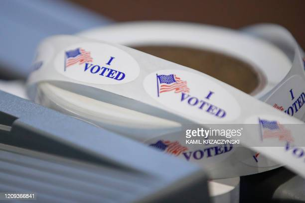I voted stickers sit on a table during a presidential primary election at the Journey Church in Kenosha Wisconsin on April 7 2020 Americans in...