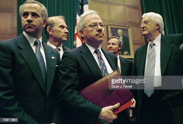 VOTEHouse managers Steve Buyer RInd Steve Chabot ROhio Bob Barr RGa Asa Hutchinson RArk and Henry Hyde RIll wait for the start of a news conference...