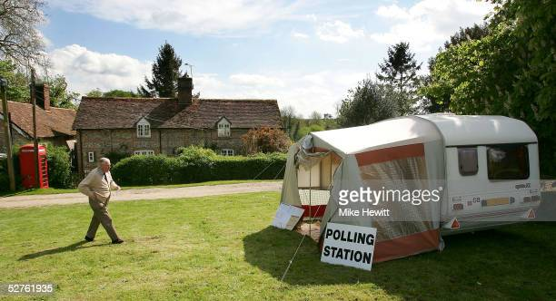 A voter approaches a caravan on Itchen Stoke green doubling as polling station on May 5 2005 in Tichborne Hampshire Voting in the general election...
