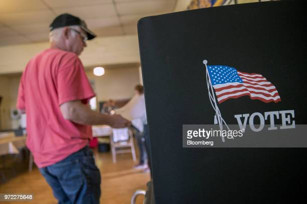 A voter arrives at a booth to fill out ballot at a polling location during the primary election in Lebanon Church Virginia US on Tuesday June 12 2018...