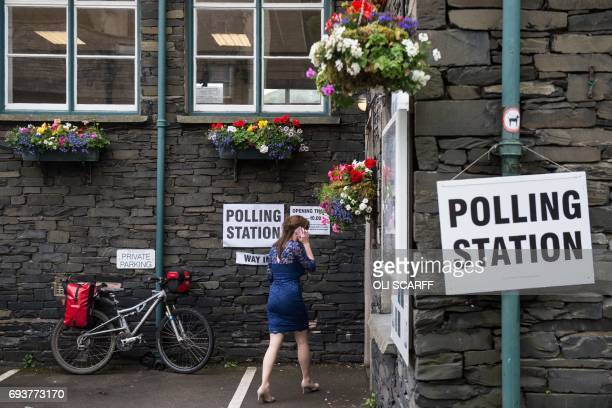A voter arrives at a polling station in Ambleside northwest England on June 8 as Britain holds a general election As polling stations across Britain...