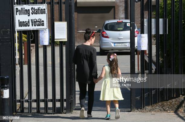 A voter arrives at St Annes schoolin south Dublin Ireland on May 25 during the Irish referendum on liberalising the abortion law People in Ireland on...