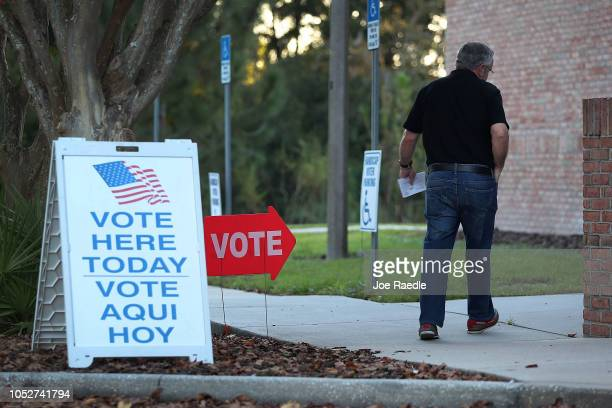 A voter arrives at the Jimmie B Keel regional library polling station to cast an early vote in Florida's elections on October 22 2018 in Tampa...