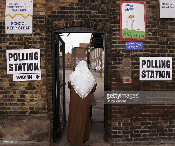 A voter arrives at the John Scurr primary school to place their ballots May 5 2005 in London Britain's voters are heading to the polls in the general...