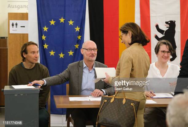 A voter arrives to cast her ballot at a polling station during European parliamentary elections on May 26 2019 in Berlin Germany Today is the last...