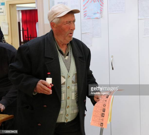 A voter arrives to cast his ballot at a polling station during local elections in Bolu Turkey on March 31 2019 Polling in Turkeys local elections...
