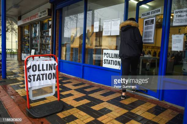 A voter arrives to cast their ballot paper at a polling station inside a laundrette on December 12 2019 in Oxford United Kingdom The current...