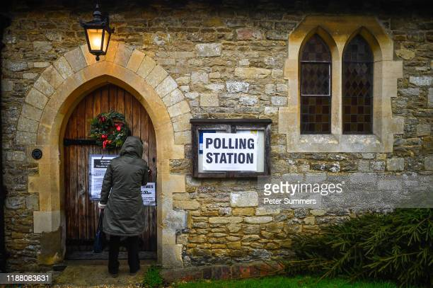 A voter arrives to cast their ballot paper at a polling station inside a church on December 12 2019 near Oxford United Kingdom The current...
