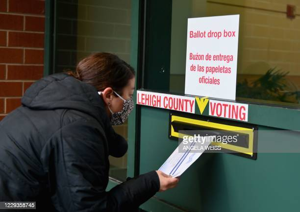 Voter arrives to drop off he ballot during early voting in Allentown, Pennsylvania on October 29, 2020.