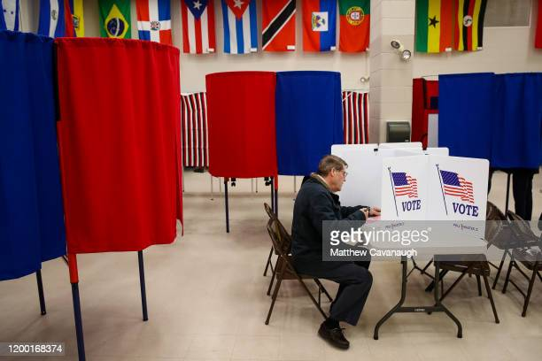 A voter cast a ballot at Bicentennial Elementary School during the New Hampshire primary on February 11 2020 in Nashua New Hampshire