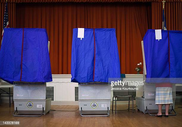 A voter cast a ballot in a voting booth during the Republican primary election April 24 2012 at St George Greek Orthodox Church in Philadelphia...