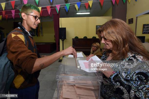 A voter casting his vote at a polling station during the Spanish general elections in El Vendrell Tarragona Catalonia