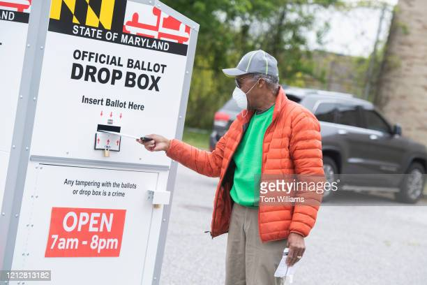 Voter casts a ballot at a drop box for either Democrat Kweisi Mfume or Republican Kimberly Klacik in the election to fill the remainder of the late...