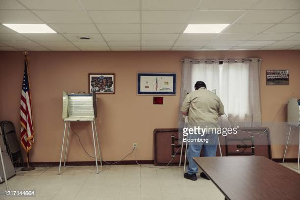 Voter casts a ballot at a polling location in Sioux Falls, South Dakota, U.S., on Tuesday, June 2, 2020. Voters for the first time in recent memory...