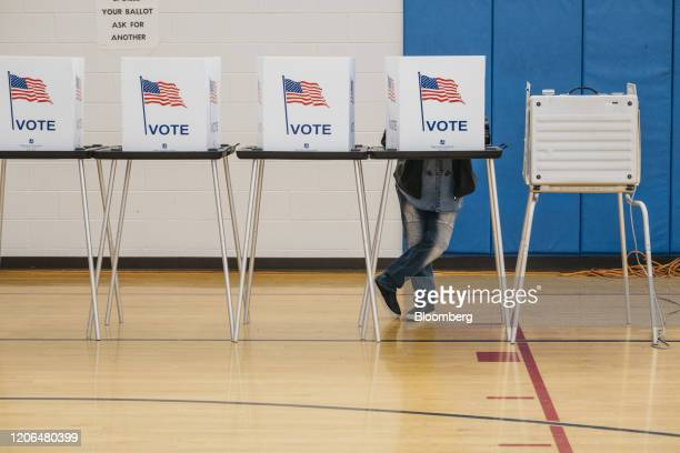 A voter casts a ballot at a polling station in Detroit Michigan US on Tuesday March 10 2020 Bernie Sanders and Joe Biden have canceled planned...