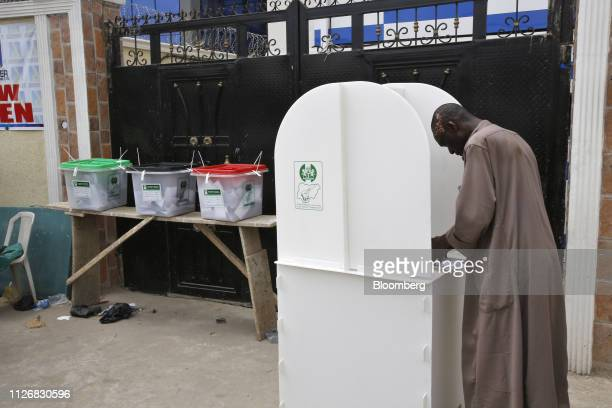 A voter casts a ballot at a polling station in Lagos Nigeria on Saturday Feb 23 2019 Nigerians began voting in Africas biggest democracy in a tight...
