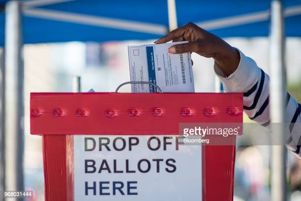 A voter casts a ballot at a polling station in San Francisco California US on Tuesday June 5 2018 Democrats are facing a potentially destructive...
