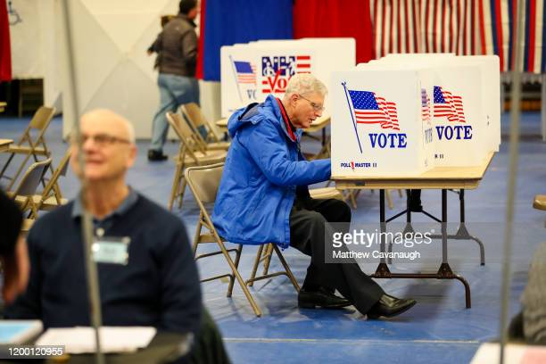 A voter casts a ballot at Bedford High School during primary voting on February 11 2020 in Bedford New Hampshire