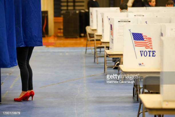 A voter casts a ballot at Bedford High School during the New Hampshire primary on February 11 2020 in Bedford New Hampshire