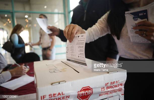 A voter casts a ballot on the final day of early voting for the upcoming Nevada Democratic presidential caucus on February 18 2020 in Las Vegas...