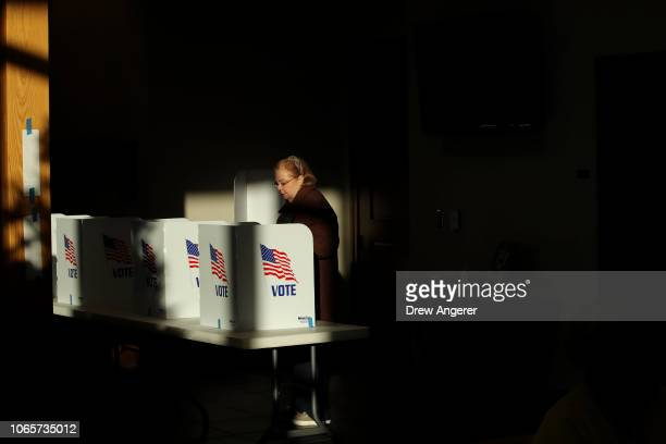 Voter casts her ballot at a polling place at Highland Colony Baptist Church, November 27, 2018 in Ridgeland, Mississippi. Voters in Mississippi head...