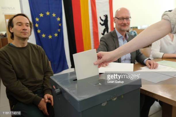 A voter casts her ballot at a polling station during European parliamentary elections on May 26 2019 in Berlin Germany Today is the last day voters...