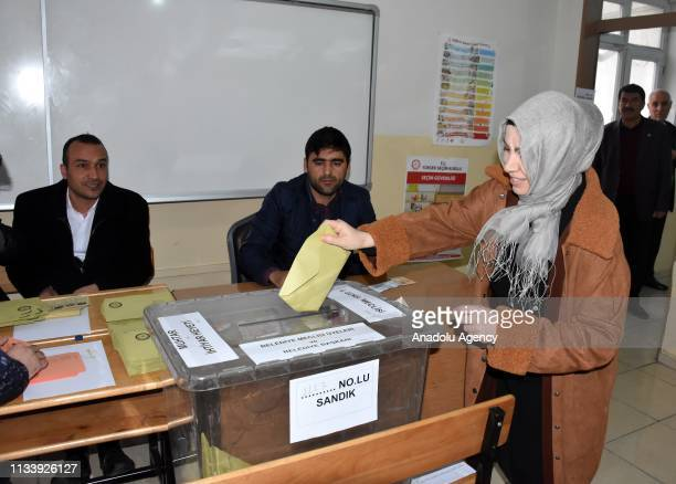 A voter casts her ballot at a polling station during local elections in Mus Turkey on March 31 2019 Polling in Turkeys local elections began on...