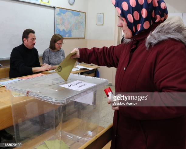 A voter casts her ballot at a polling station during local elections in Bolu Turkey on March 31 2019 Polling in Turkeys local elections began on...
