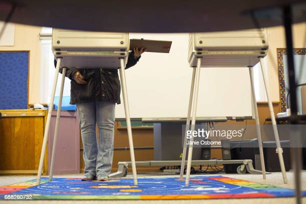A voter casts her ballot for Montana's special House election between Republican Greg Gianforte and Democrat Rob Quist in one of the two voting...
