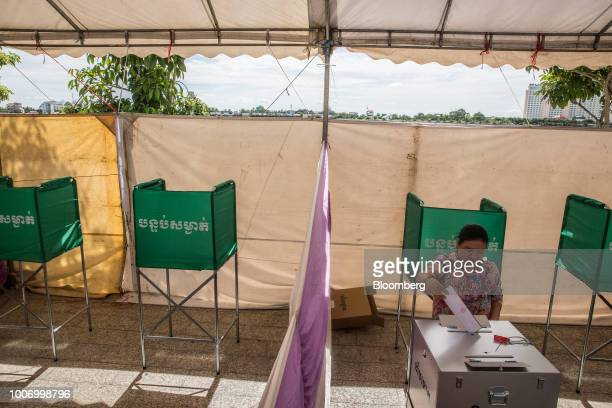 A voter casts her ballot for the general election at a polling station in Phnom Penh Cambodia on Sunday July 29 2018 As Cambodians vote on Sunday a...