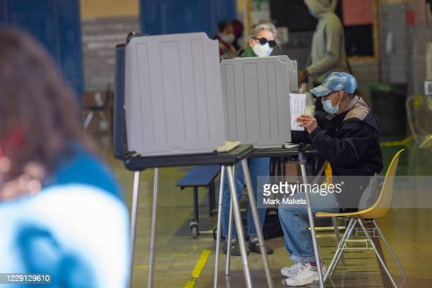 Voter casts her early voting ballot at the A. B. Day School polling location on October 17, 2020 in Philadelphia, Pennsylvania. With the election...