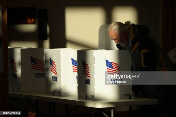 A voter casts his ballot at a polling place at Highland Colony Baptist Church November 27 2018 in Ridgeland Mississippi Voters in Mississippi head to...