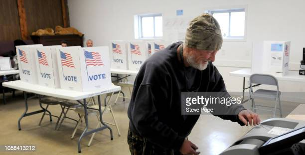 A voter casts his ballot at a polling place in Iowa's Madison County on November 6 2018 in Truro Iowa Congressman David Young is in a tight race...