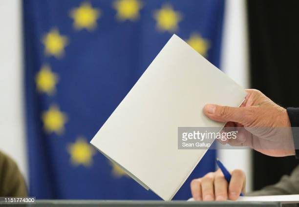 A voter casts his ballot at a polling station during European parliamentary elections on May 26 2019 in Berlin Germany Today is the last day voters...
