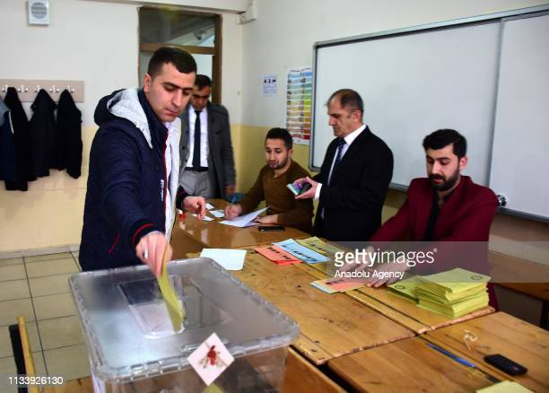 A voter casts his ballot at a polling station during local elections in Mus Turkey on March 31 2019 Polling in Turkeys local elections began on...