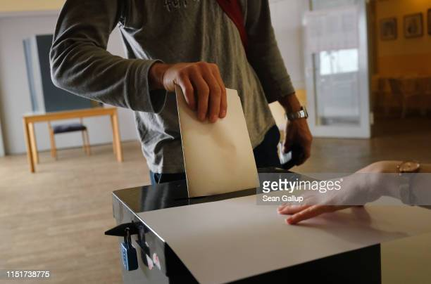 A voter casts his ballot at a polling station in European parliamentary elections on May 26 2019 in Berlin Germany Today is the last day voters...