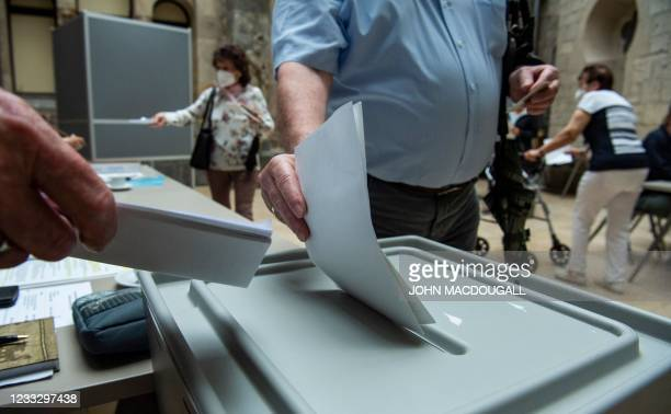 Voter casts his ballot at a polling station in Magdeburg's Art History museum on June 6 during regional elections in the German state of...