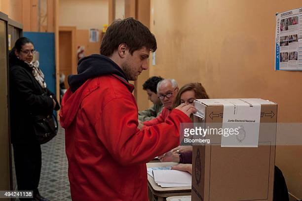 A voter casts his ballot for president at a polling station in Buenos Aires Argentina on Sunday Oct 25 2015 Argentina is moving a step closer toward...
