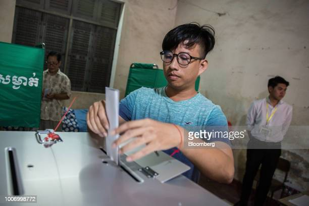 A voter casts his ballot for the general election at a polling station in Phnom Penh Cambodia on Sunday July 29 2018 As Cambodians vote on Sunday a...