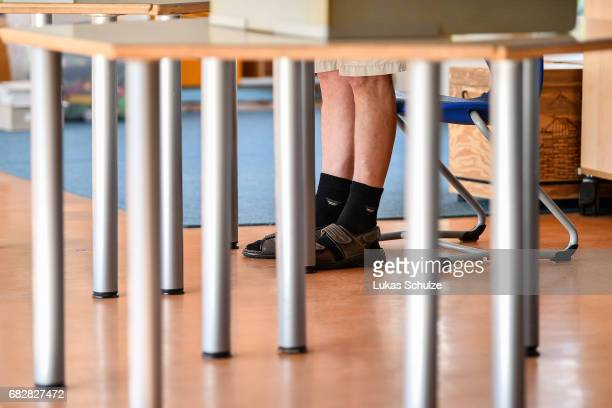 A voter casts his ballot in state elections in North RhineWestphalia on May 14 2017 in Aachen Germany The election today the third German state...