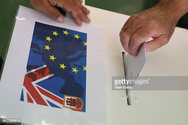 A voter casts his ballot in the EU Referendum on June 23 2016 in Gibraltar The United Kingdom and its dependant territories are going to the polls...