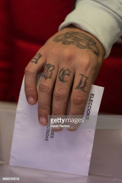 A voter casts his ballot paper on December 21 2017 in Barcelona Spain Catalan voters are heading to the polls today to elect a new regional...