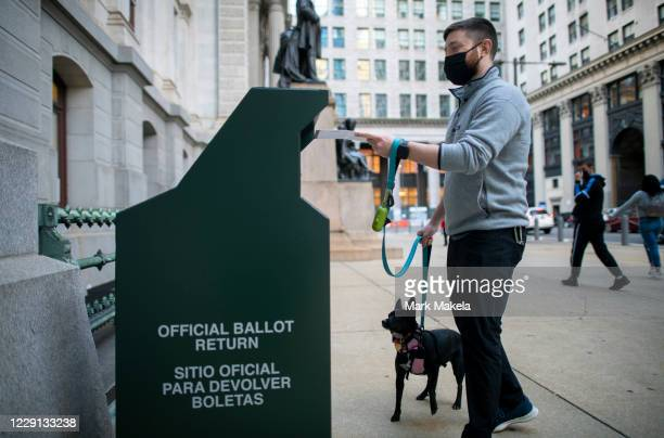 Voter casts his early voting ballot at drop box outside of City Hall on October 17, 2020 in Philadelphia, Pennsylvania. With the election only a...