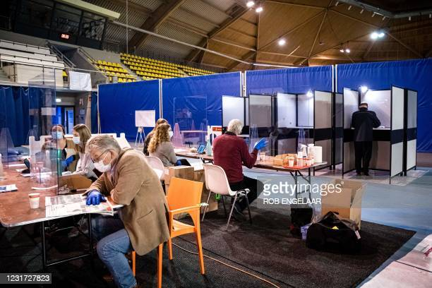 Voter casts his vote for the House of Representatives elections, during early voting at a polling station which will open for three days as voting is...