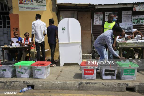 A voter casts his vote in the ballot box at a polling station in Lagos Nigeria on Saturday Feb 23 2019 Nigerians began voting in Africas biggest...