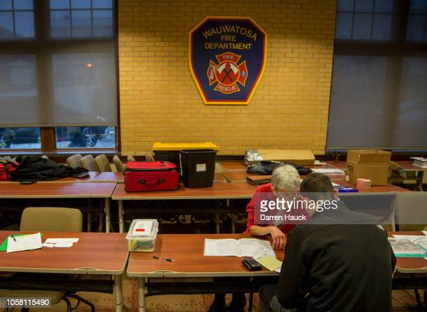 Voter checks in before casting a midterm ballot on November 6, 2018 in Wauwatosa, Wisconsin. Voters are turning out in historic numbers to cast...