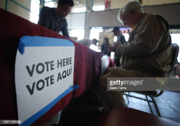 A voter checks in on the final day of early voting for the upcoming Nevada Democratic presidential caucus on February 18 2020 in Las Vegas Nevada...