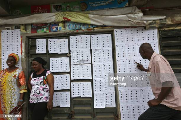A voter checks information displayed at a polling station in Lagos Nigeria on Saturday Feb 23 2019 Nigerians began voting in Africas biggest...